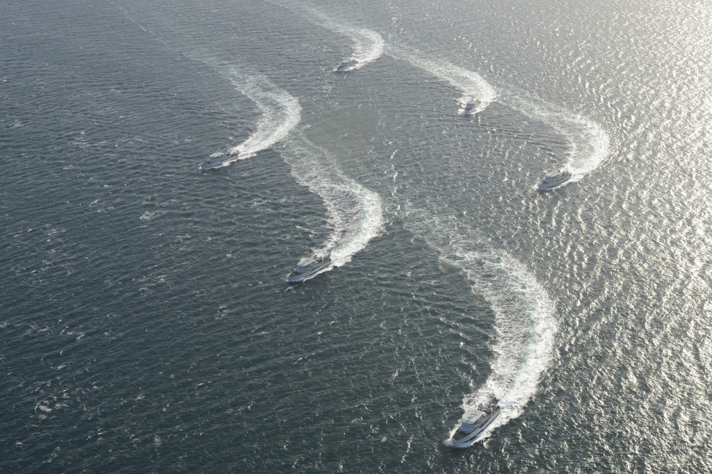 Six Patrol Craft Training (PCT) vessels conduct a starboard turn in formation in the Straight of Juan de Fuca on 14 February 2014.
