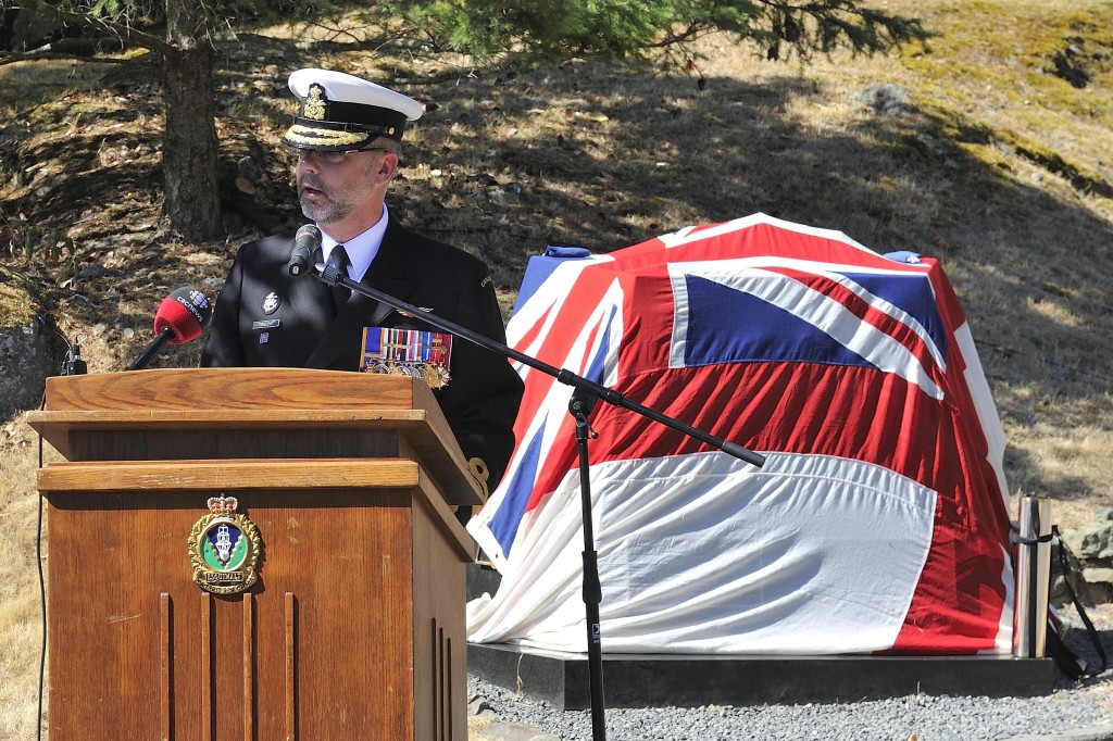 RAdm Bill Truelove, Commander MARPAC, speaks before the unveiling of the rededicated Submarine Memorial Cairn at CFB Esquimalt on August 7, 2014.