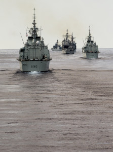 Canadian and Allied ships performing maneuvers while on Task Group Exercise (TGEX) off the Atlantic Coast on 11 August 2014.