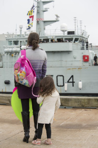 Kayleigh Getson, along with her mother Katrina Getson, waits patiently to be reunited with her father, Leading Seaman J. Barrieau serving aboard HMCS SHAWINIGAN, at Jetty NB, Naval Dockyard, Canadian Forces Base Halifax on 30 September, 2014. ©DND 2014 Photo: LS Peter Frew, Formation Imaging Services Halifax